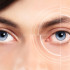 Closeup of blue eyes from a young man red and irritated eye with